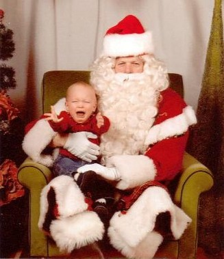 Photo of a kid crying on Santa